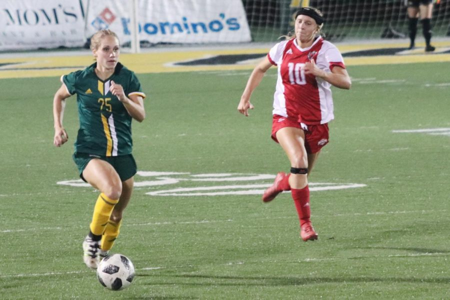Payton Colson, a senior forward, competes in her last home game of her collegiate soccer career.
