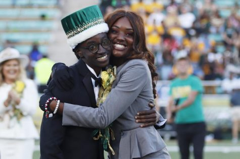 2018 Homecoming King Cedric L. Dent, a senior social work major, and 2018 Homecoming Queen Da'Jon Beard, a junior early childhood education major, hug on the field after having their names called as the new king and queen.
