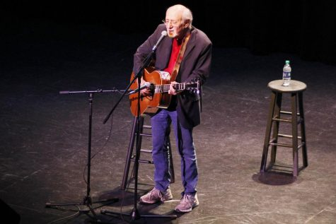 Peter Yarrow sings on the stage of the Columbia Theatre.