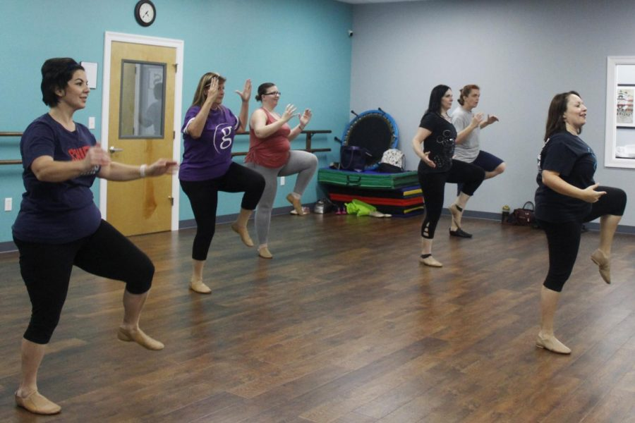 Adult dancers with Soar Creative Arts Center begin with a fun warmup to start the class led by Ashley McGlothren, an alumna.