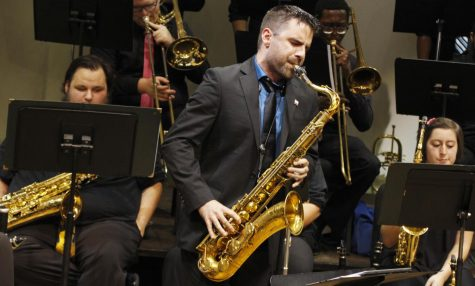 Brad Walker, guest saxophonist, performs with the jazz ensemble at their first concert of the season.