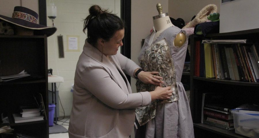 Instructor of Costume and Makeup Design Emily Billington prepares one of her costumes.