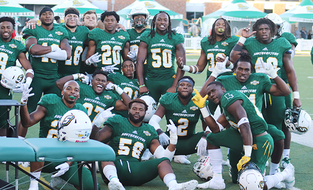 "The Lions football team poses after beating McNeese State University on ""Senior Day"" 23-6. The players wear uniforms sponsored by athletics' partnership with Adidas."