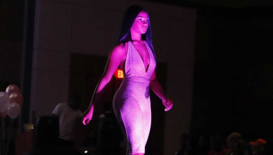 Delta Sigma Theta Sorority, Inc. put on its first fashion show to display the clothing of Jazelle Harris, co-founder of 3's A Charm.
