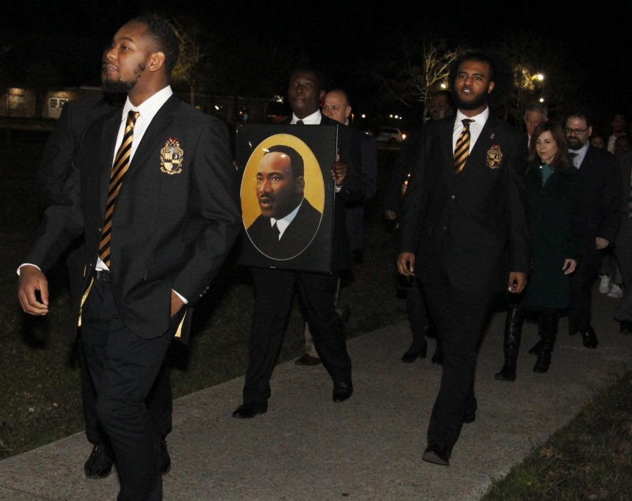 Members of Alpha Phi Alpha Fraternity Inc. lead a memorial program for Dr. Martin Luther King Jr. The program began with a march at 6 p.m. followed by a gathering in the University Center.