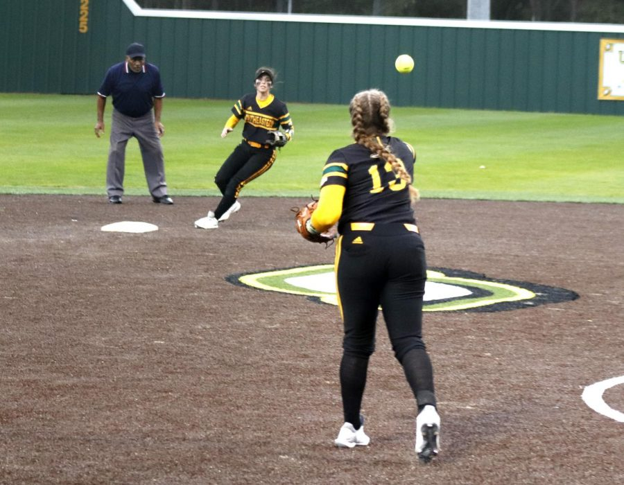 During the game against Prairie View A&M University, Maidson Watson, a sophmore infielder, throws the ball to Jaquelyn Ramon, a senior infielder. The Lady Lions started the tournament 1-0 after a 7-0 win against Prairie View.