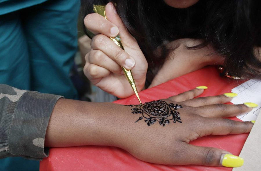 Students stopped by the Nepalese Student Associations table to get henna tattoos. The event raised money for the annual Holi celebration.