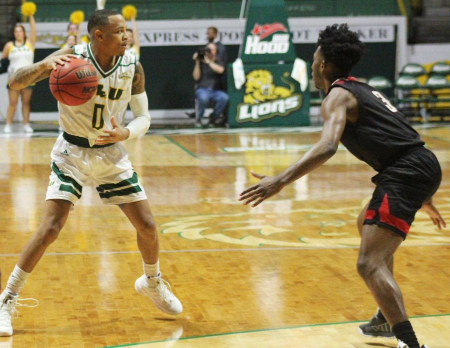 Marlain Veal, senior guard, looks for an open pass in Saturday's game against Nicholls State University. The Lions beat the Colonels 91-70.
