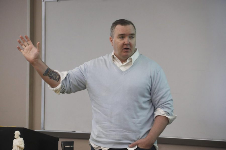 Dr. Peter Gratton, assistant professor of history and political science, teaches philosophy in Fayard Hall. He advises anyone considering a tattoo to think about how what they get will reflect on them as a person. Some believe tattoos are becoming more accepted in a professional workplace though the degree varies depending on profession and employer.