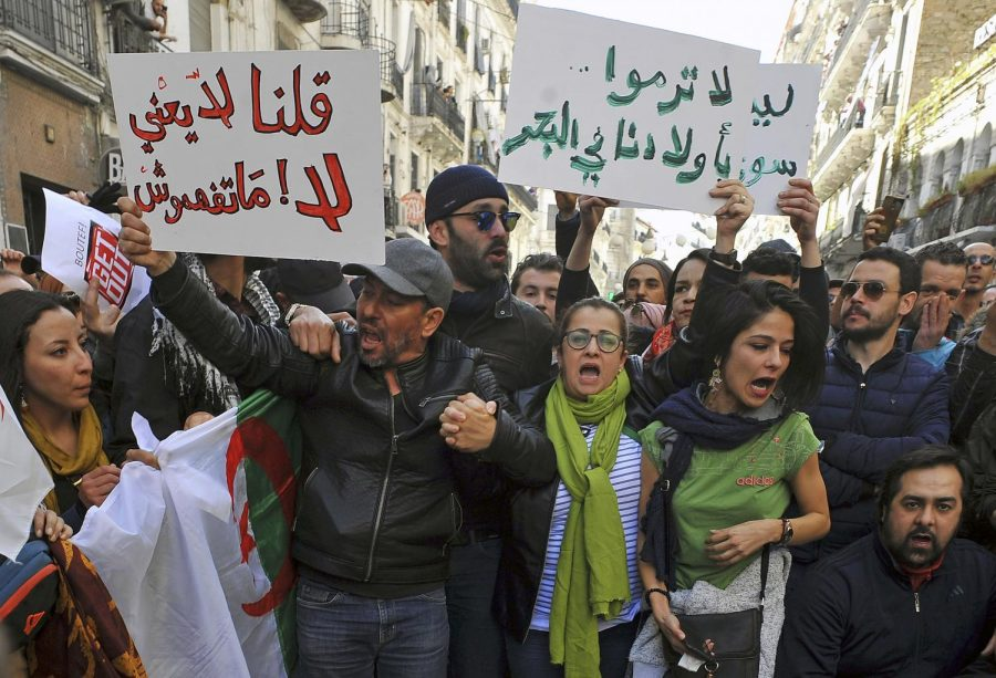 Demonstrators gather during a protest to denounce President Abdelaziz Bouteflika's bid for a fifth term, in Algiers, Algeria, Sunday, Feb. 24, 2019. Hundreds of protesters have gathered in Algeria's capital for the second time this week to denounce ailing Bouteflika's bid for a fifth term.