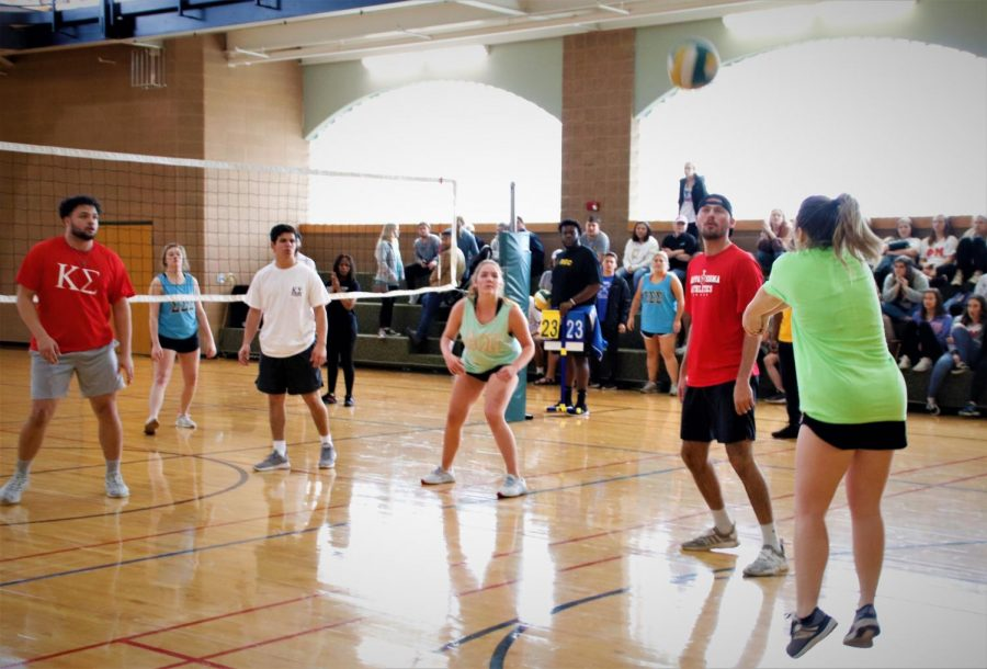 During the championship match, Alpha Omicron Pi Team B attempts to return the volley. Their team won the game against Sigma Sigma Sigma Team A.