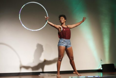 Ariana Robinson, a freshman art major, performs with hula hoops on stage in the Student Union Theatre. Robinson won a $500 scholarship for placing in first.