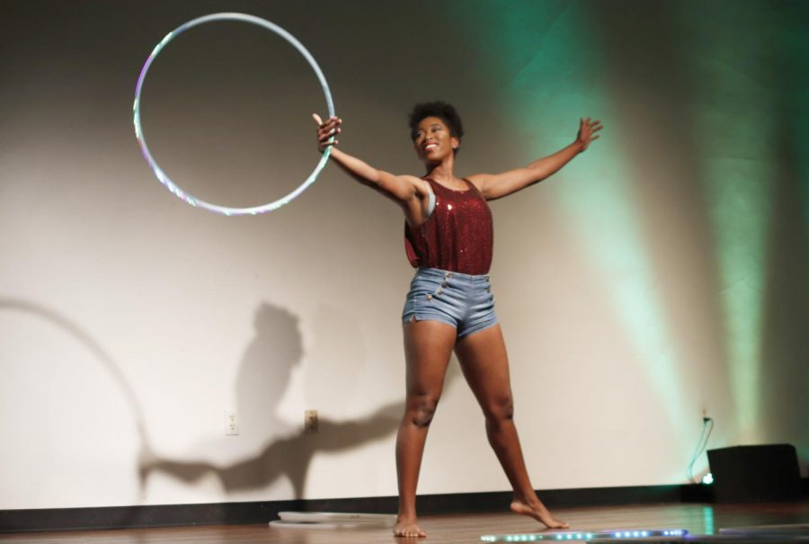 Ariana+Robinson%2C+a+freshman+art+major%2C+performs+with+hula+hoops+on+stage+in+the+Student+Union+Theatre.+Robinson+won+a+%24500+scholarship+for+placing+in+first.+