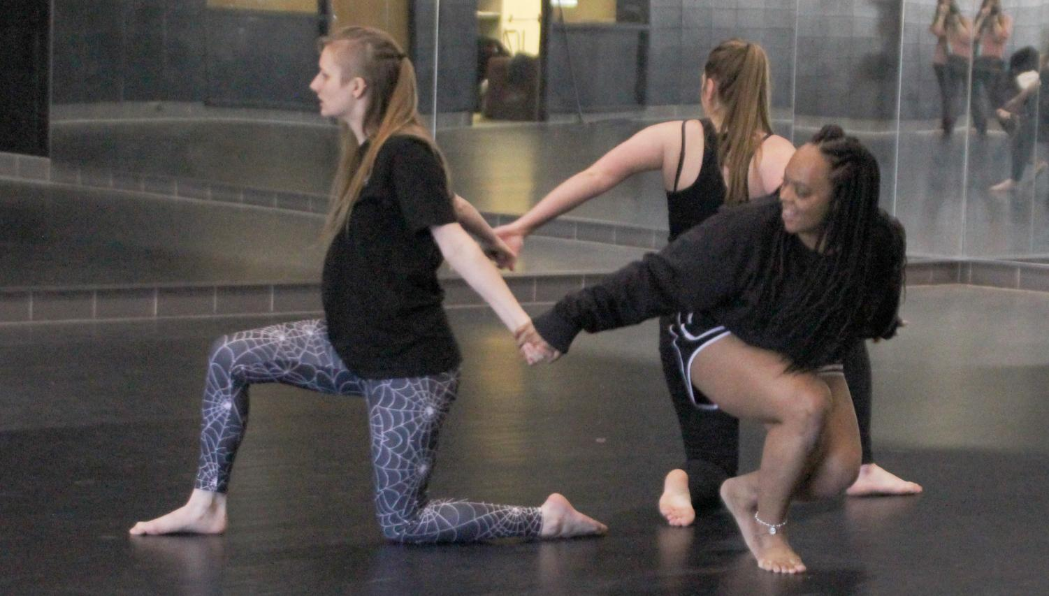 Members of Chi Tau Epsilon, the university's dance fraternity, practice a choreographed routine. Dance can increase levels of serotonin and help reduce stress.