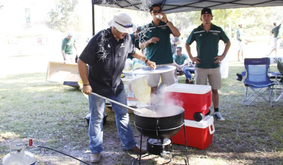 "A competitor checks his dish at the 2016 Gumbo Cook Off in Friendship Circle.  Cook-offs such as the upcoming ""Jaycees Harry McKneely Memorial Jambalaya Cook-Off"" are a common form of fundraising."