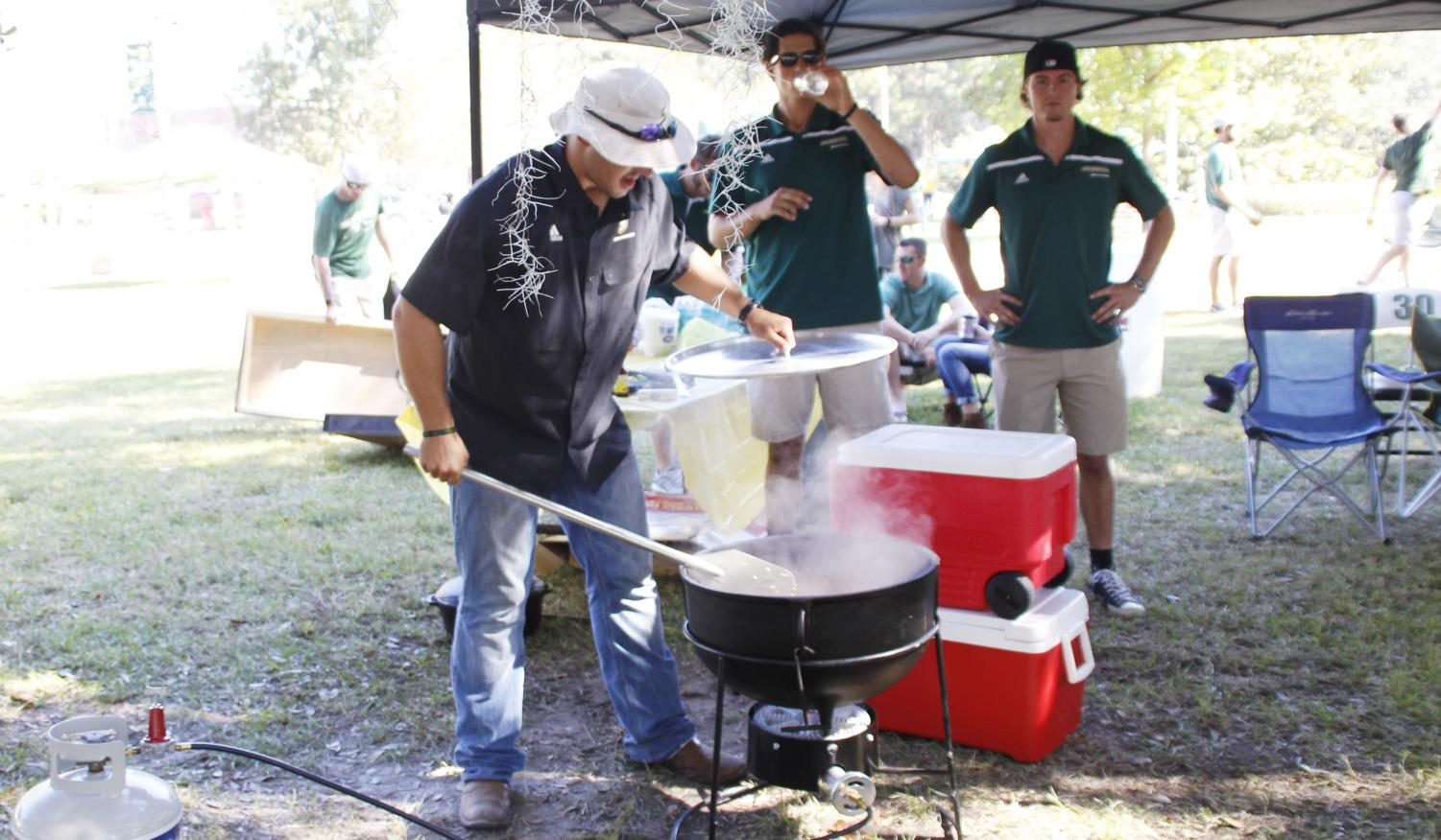 """A competitor checks his dish at the 2016 Gumbo Cook Off in Friendship Circle.  Cook-offs such as the upcoming """"Jaycees Harry McKneely Memorial Jambalaya Cook-Off"""" are a common form of fundraising."""