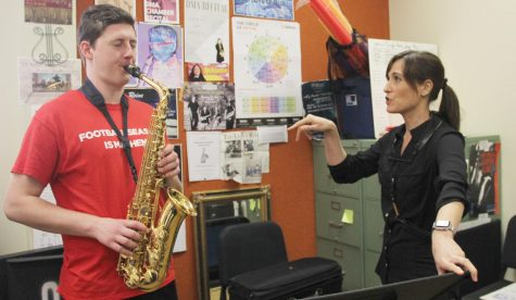 Brina Faciane, instructor of saxophone, teaches Austin Hynes, a junior music major, on the instrument.