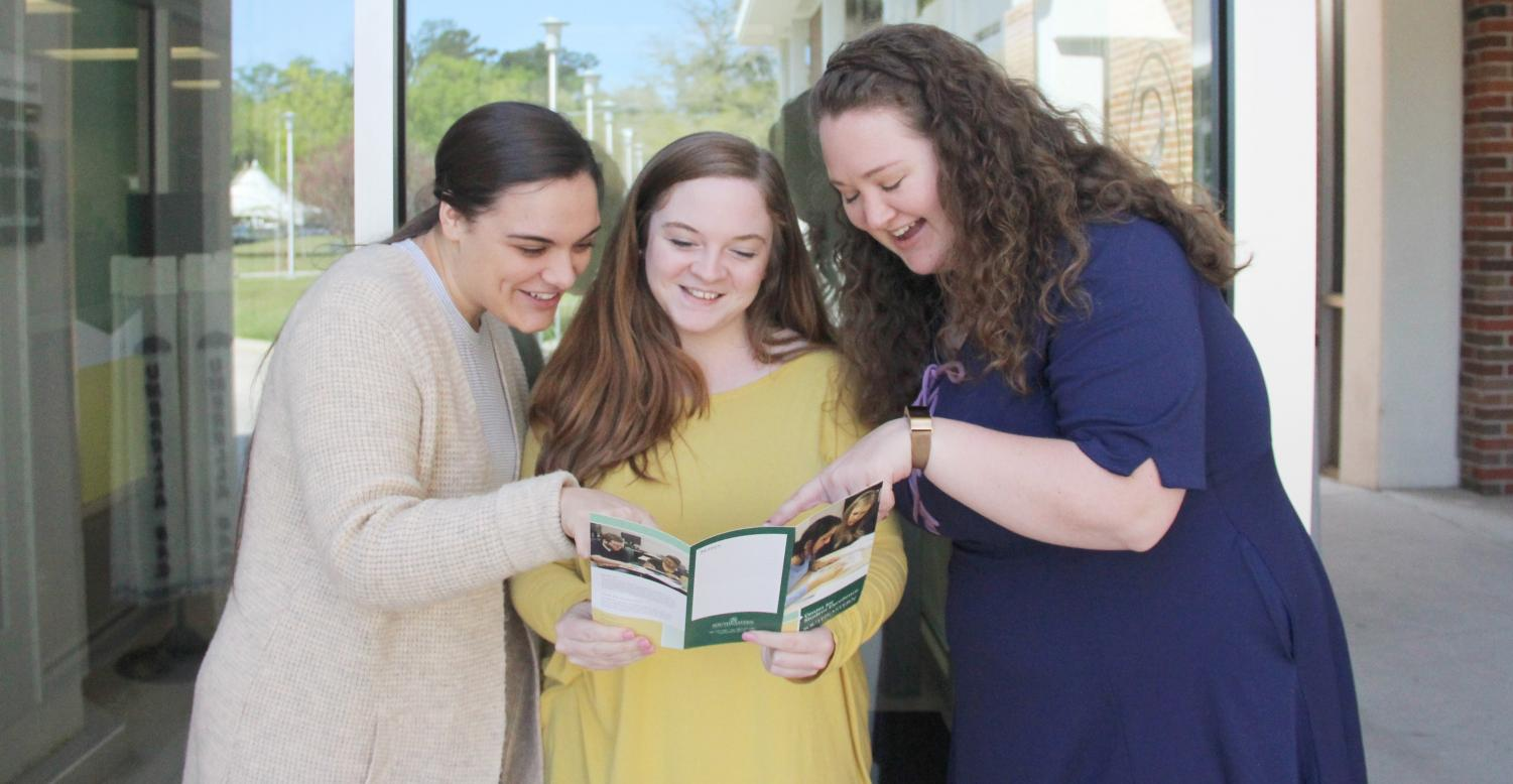 Left, Hannah Nemar, a senior communication sciences and disorders major, middle, Kayla Scurich, a graduate student, and right, Kassie deArmas, a graduate student, discuss the amenities offered by Center for Student Excellence.