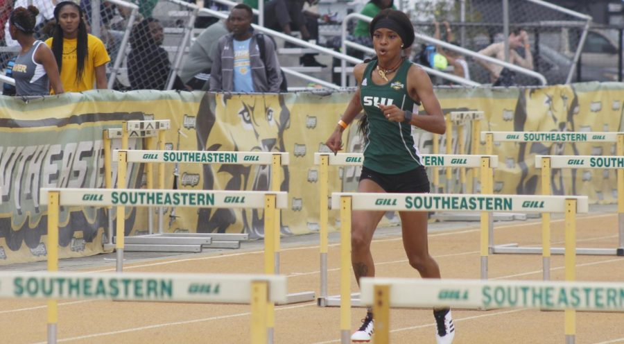 Daisha Nickelson, a sophomore hurdler on the track and field team, runs her event, the 100-meter hurdles, at the Strawberry Relays. Nickelson's love of playing sports led her to pursue being a college athlete.