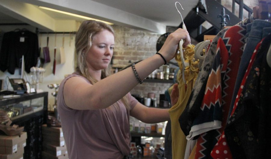 Sarah Cobb, an employee of Ruby, checks over the prices and values of the clothes. Fashion design uses a variety of STEM-related skills to enhance the field.