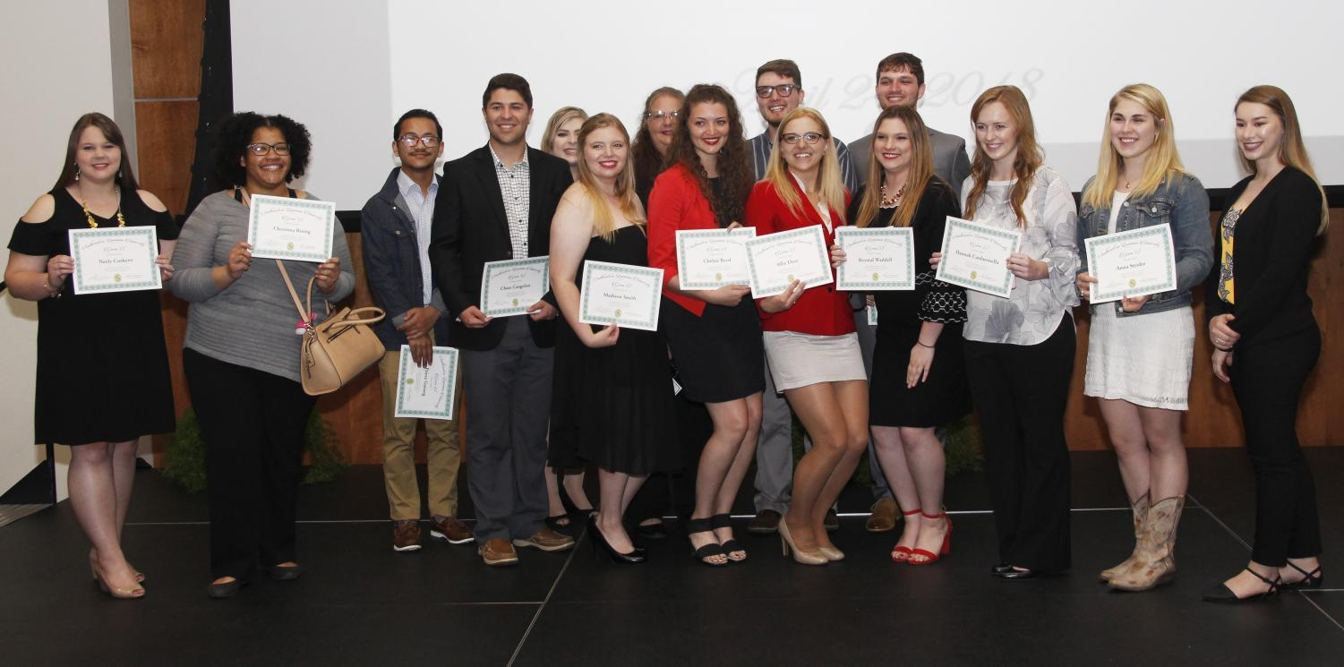 "Students pose for a picture after receiving their awards at the 38th ""Division for Students Affairs Convocation."" The convocation recognizes students' achievements every spring."