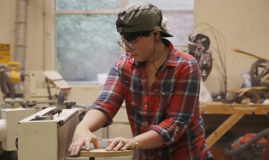 Abigail Coleman, a senior art major, works on her project in a class taught by Jeff Mickey, professor of sculpture. While materials may be provided in class, a working artist has to manage the financial cost of their career.