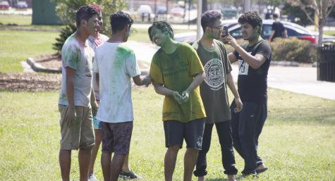 Members of Nepalese Students Association at Southeastern celebrate Holi, a festival of colors, in front of the Pennington Student Activity Center.