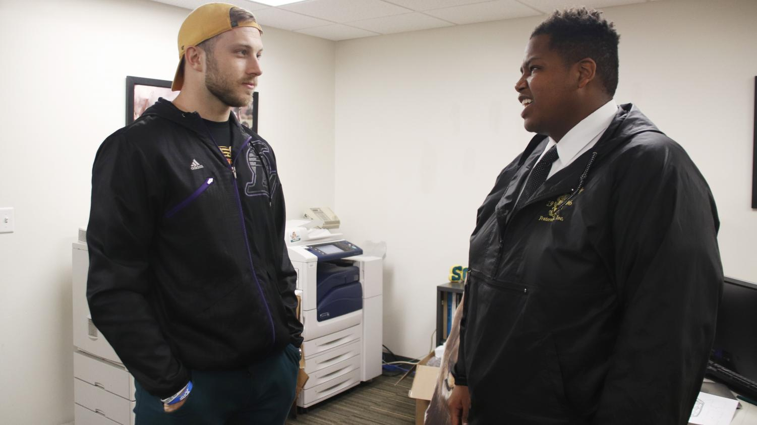 """Johannes """"Joey"""" Verhaegh, a graduate assistant for Multicultural and International Student Affairs and a former member of the Lions football team, left, speaks with Richard Davis Jr., president of the Student Government Association, right. From their position in the public, athletes can find their voices bringing attention to political topics."""