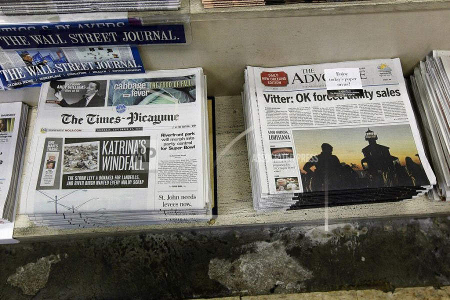 In this Thursday, Sept. 27, 2012 file photo, free introductory copies of the Baton Rouge Advocate's new New Orleans edition, right, are seen next to copies of the New Orleans Times-Picayune at Lakeside News in the New Orleans suburb of Metairie, La. The owners of Louisiana's The Advocate newspaper have purchased The Times-Picayune in New Orleans from Advance Local Media. The Advocate announced the purchase on its website Thursday, May 2, 2019.