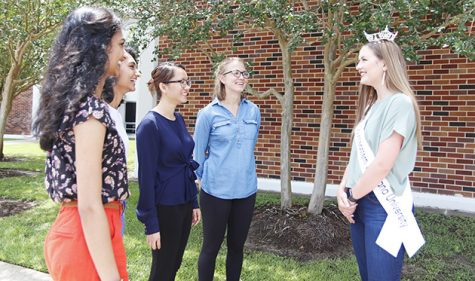 Shreeja Bhatt, Shreya Bhatt, Xuyen Nguyen and Clarissa Smith, senior chemistry majors, talk to Chelsey Blank, Miss Southeastern Louisiana University. In her leadership position, Blank tries to be a role model for others on campus.