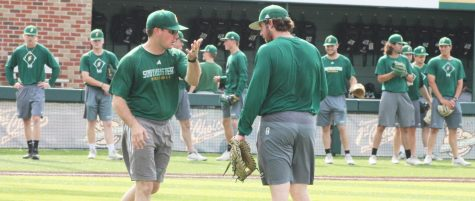 Kyle Schimpf, a senior infielder, works with one of the assistant coaches during practice. Schimpf, like many other graduating seniors, has made memories at the university during his time as a student athlete.