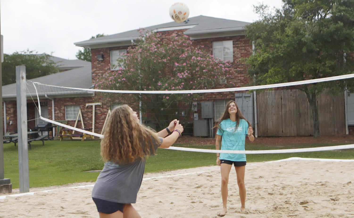 Students play volleyball at the sand court in Greek Village. Beach Volleyball has been added as an NCAA sport, and the university plans to begin competing in 2020 with Jeremy White as the head coach of beach volleyball.