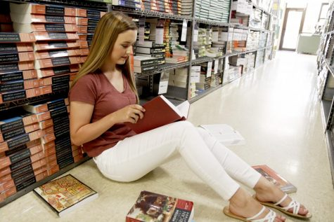 Miss Southeastern Louisiana University Chelsey Blank peruses books in textbook rental as she prepares for her senior year of college.