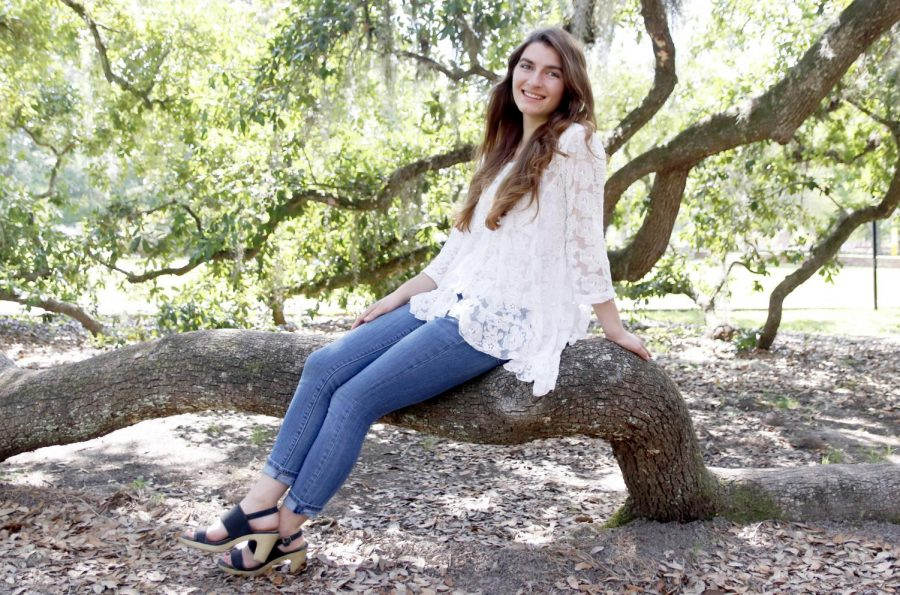 Victoria Rocquin, a junior communication major, poses under Friendship Oak. Rocquin was recently awarded the Women of Excellence Award by the Louisiana Legislative Women's Caucus Foundation Scholarship.