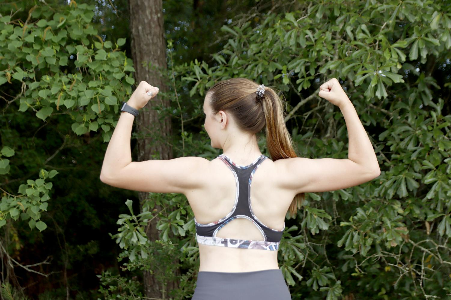 Miss Southeastern Louisiana University Chelsey Blank shows off her muscles during a summer workout. Staying healthy during the summer is more difficult for students due to a less structured schedule according to assistant professor of athletic training Dr. Ryan Green.