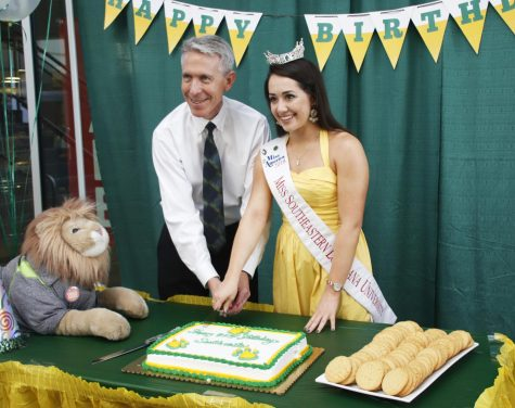 Dr. John Crain, president of the university, cuts cake with Miss Southeastern 2018 Alyssa Larose during the university birthday celebration organized by the Campus Activities Board. The institution that began as Hammond Junior College in 1925 will turn 94 this year.