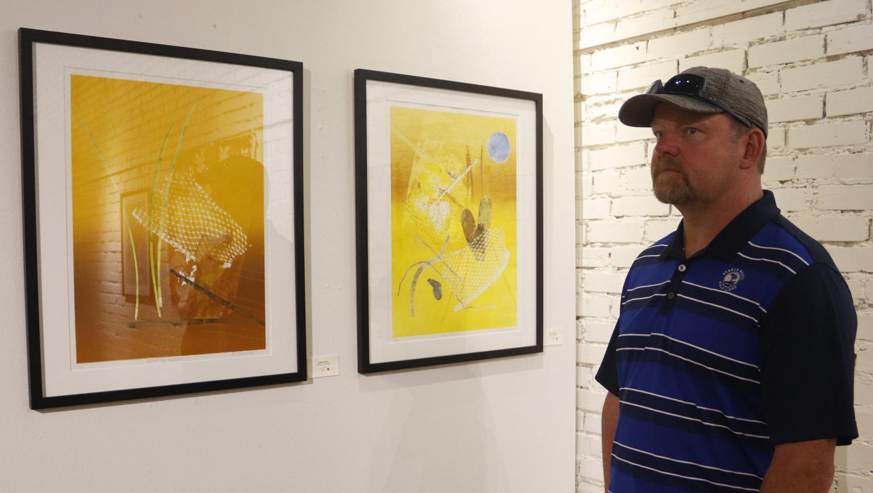 Hammond resident Scott Rohner observes Rosemary Goddell's art work on display. Godell's work is a part of Zen Aesthetics exhibition. Prakriti Adhikari/The Lion's Roar