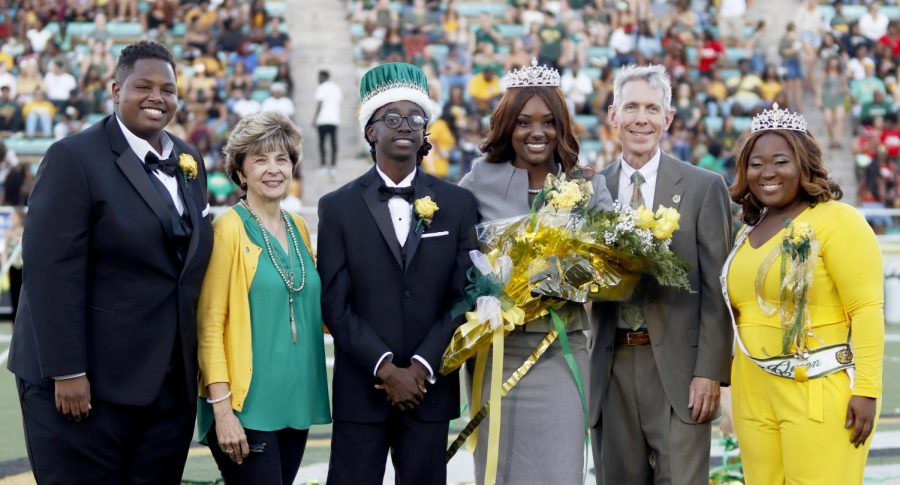 President John L. Crain stands with the 2018 Homecoming King Cedrick Dent, Jr.,  and Queen Da Jon Beard after they were crowned during the halftime show of the Homecoming football game. Beard represented Delta Sigma Theta Sorority, Inc., as a junior maid and Dent represented Alpha Phi Alpha Fraternity, Inc., as a senior beau court member. Mattie Hawkins, Homecoming Queen 2017 was on hand to crown the winners.