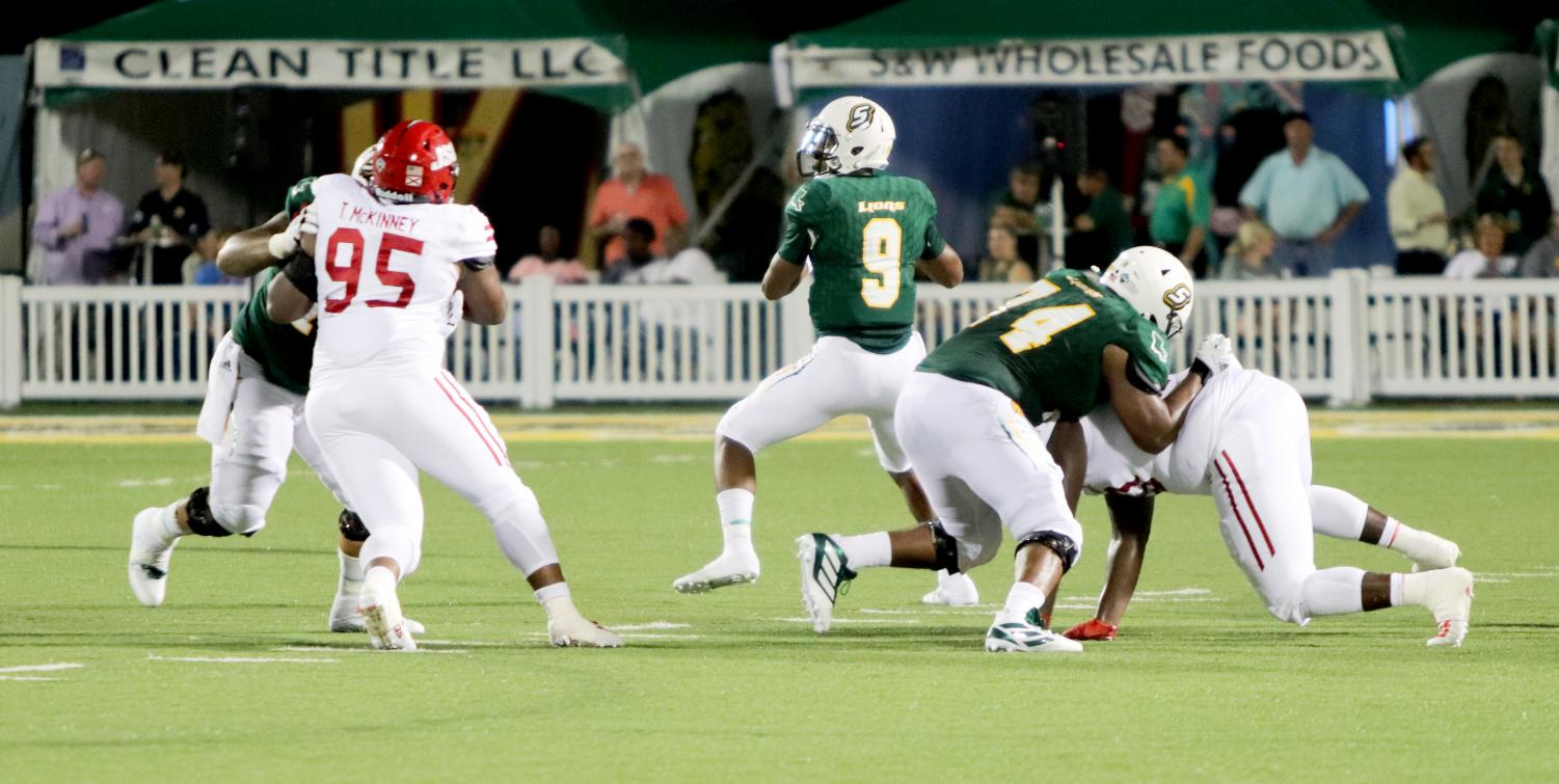 Marcus Cooper, a sophomore running back, returns a kick in the Lions' opening game against Jacksonville State University.