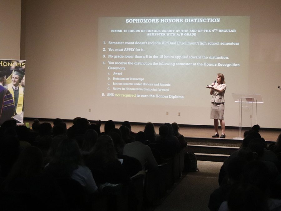 Dr. Claire Procopio, director of the honors program, speaks to the gathering of honors students at the Freshmen Convocation. Students learned about the requirements of the program and how to excel as an honor student.