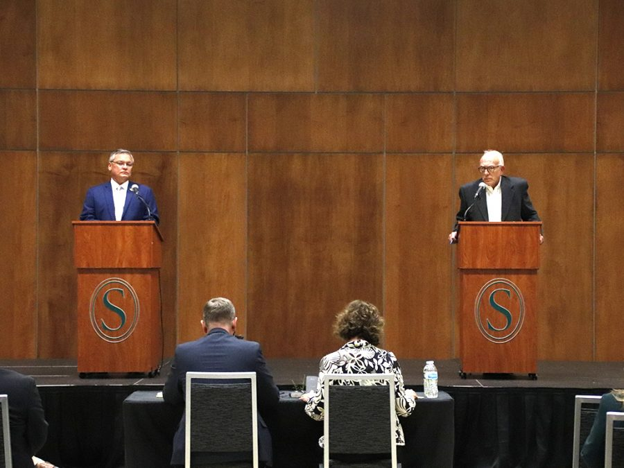 Steve Pugh, a Republican member of the Louisiana House of Representatives for District 73 in Tangipahoa Parish, and Robert Zabbia, mayor of Ponchatoula since 2004, stand on stage for The Race is On! Candidate Forum. Each candidate was given two minutes to answer questions submitted to the forum.