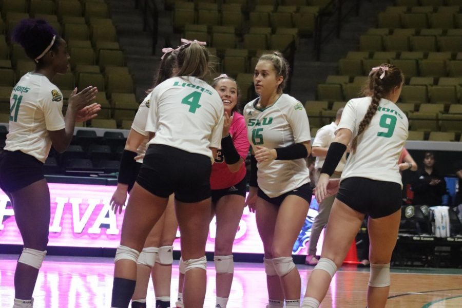 The university's women's volleyball team breaks the huddle in the second set against the University of New Orleans on Oct 29. The Lady Lions shut out UNO 3-0 to earn their 12th victory of the season.
