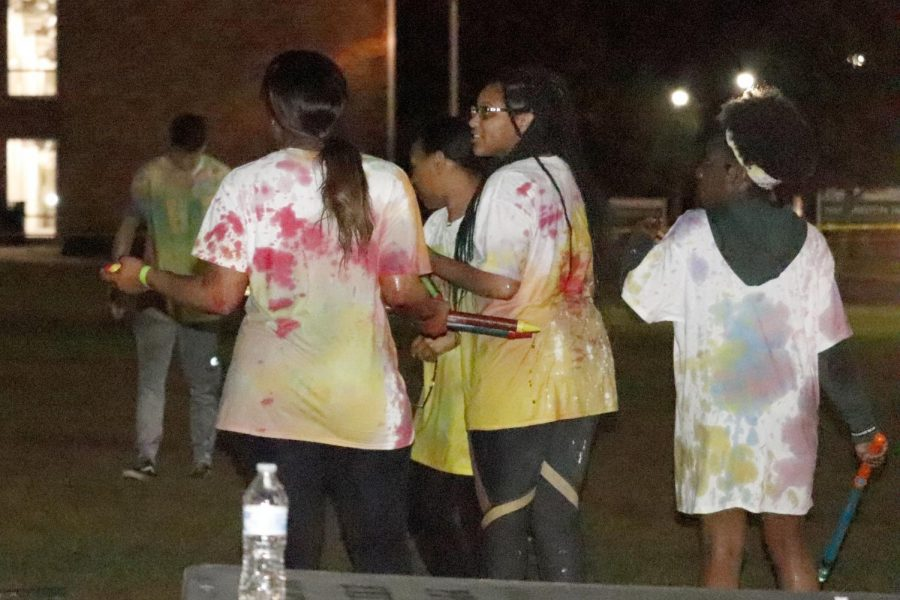 Students play with paint at Lee field during Paint Party organized by the Residents Hall Association.