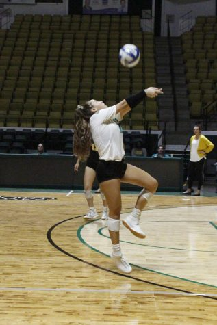 Alexis Pratt, defensive specialist, serves the ball at the University Center in the game against Lamar University.
