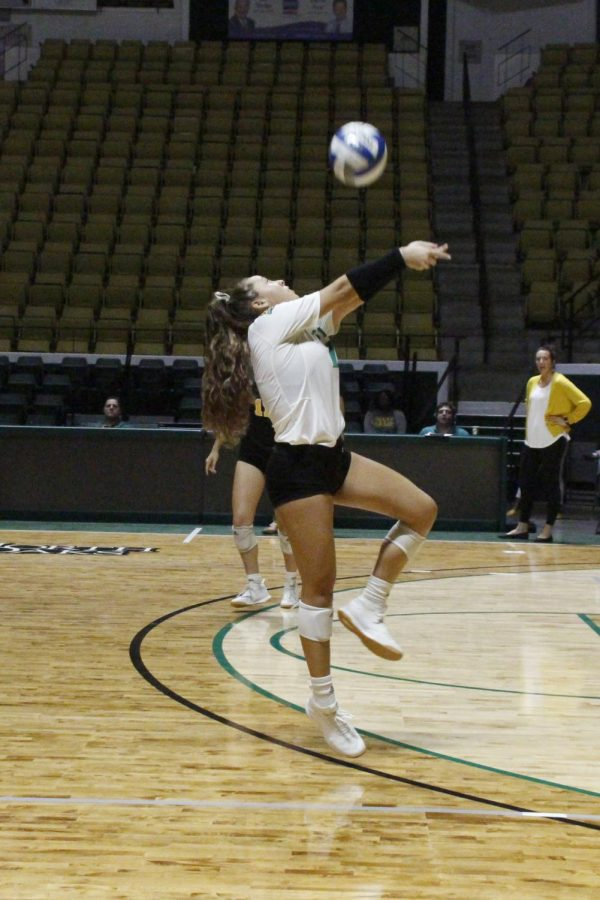Alexis+Pratt%2C+defensive+specialist%2C+serves+the+ball+at+the+University+Center+in+the+game+against+Lamar+University.