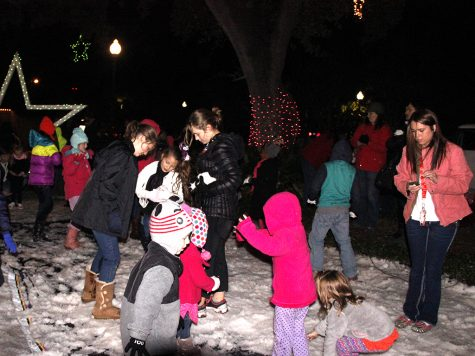 Young attendees enjoy the downtown Hammond lights and faux snow during the 2014 Starry November Night.