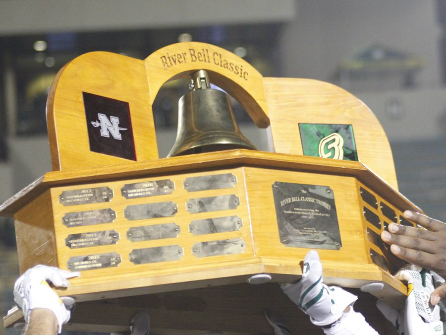 Southeastern football players raise the River Bell Trophy after defeating Nicholls State University 21-17 in 2017. This will be the first time both schools are ranked in the River Bell Classic game. Nicholls and Southeastern will be playing for the Southland Conference title.