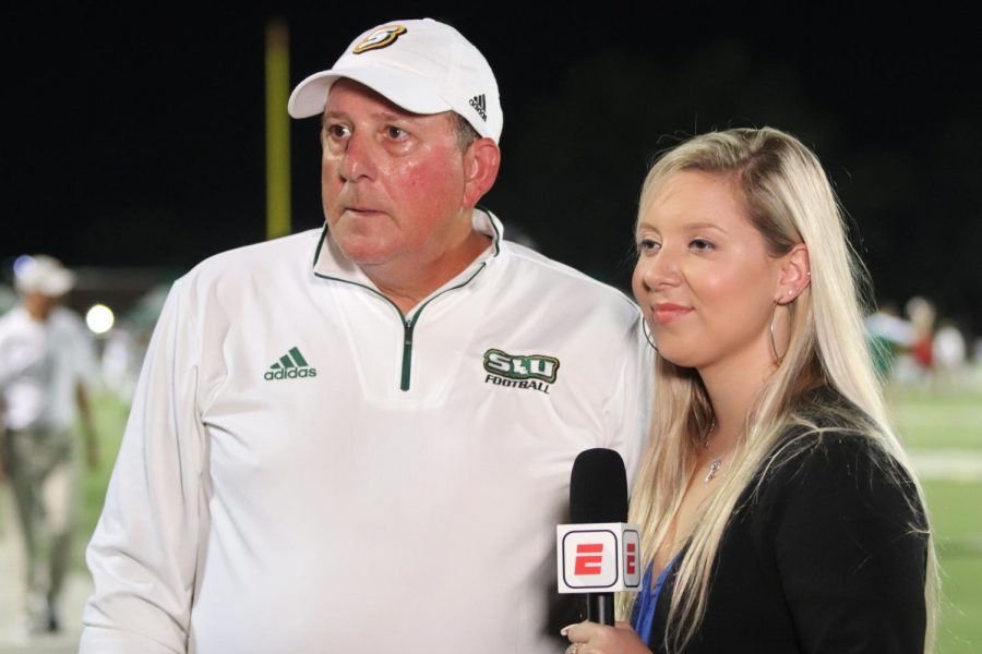 Frank Scelfo, head coach of football, is interviewed during halftime of the Aug. 29 game against Jacksonville State University in which the Lions won 35-14. After going 4-7 in the 2018 season, Scelfo has led the Lions to five wins through eight games in the 2019 season. The football team is currently in second place in the Southland Conference.