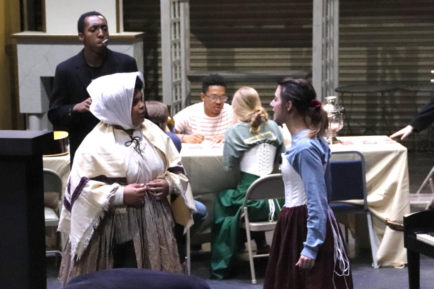"""Dejuan James and Payton Core rehearsing at the Vonnie Borden on Nov. 8.  """"I've liked growing as an actor. This has been the most challenging role ever in my life,"""" shared Core. Jacob Lofton/The Lion's Roar"""