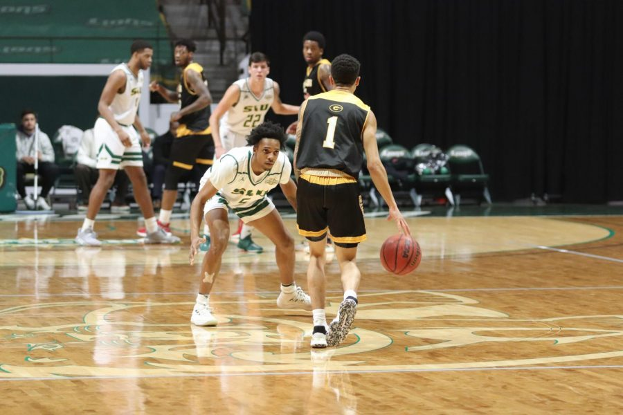 Freshman guard Byron Smith guards the Grambling State University point guard. Smith finished the game with eight points and two rebounds. With the loss the Lions fall to 1-2.
